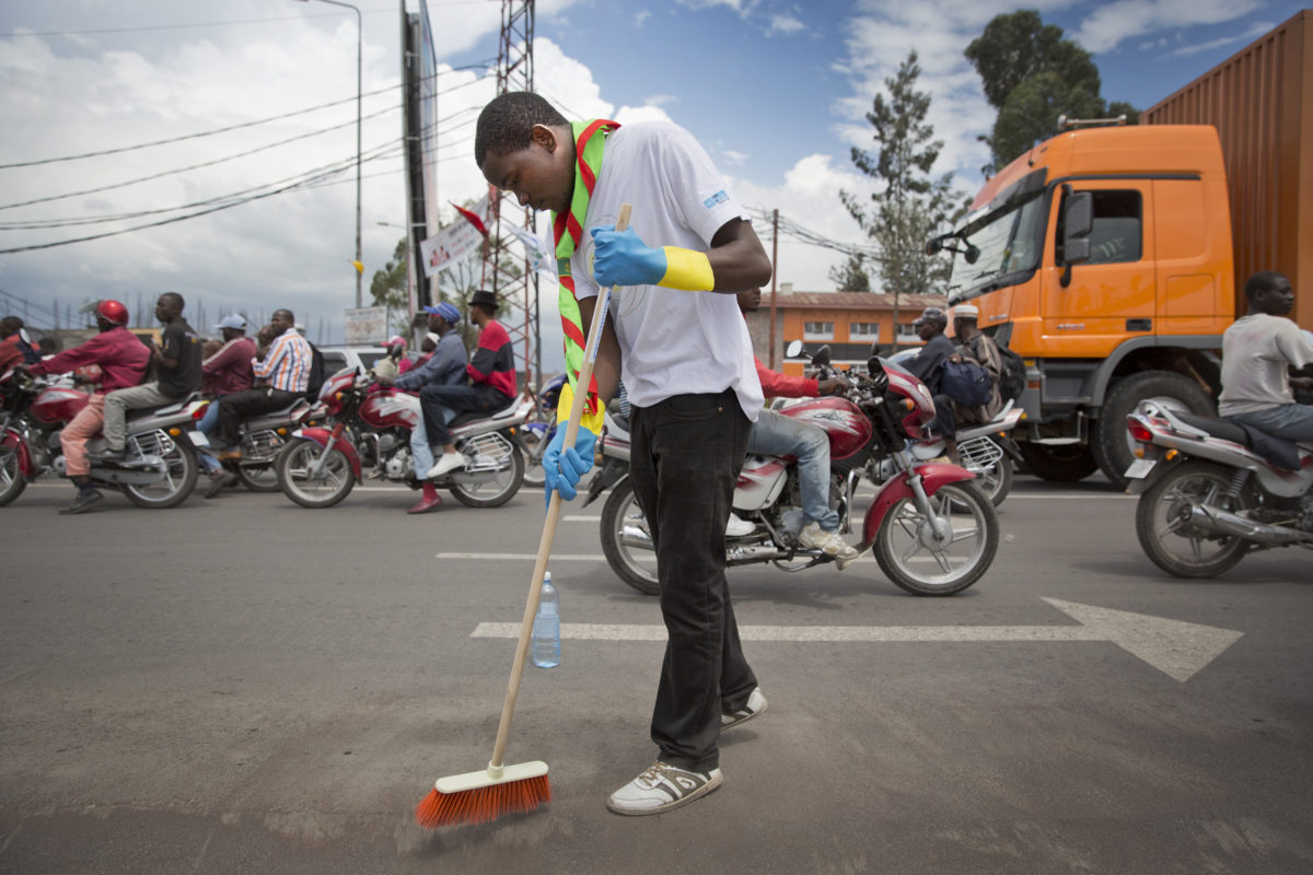 A member from a local volunteer association help clean a main Road in Goma during Volunteer day, the 30th of November 2013. © MONUSCO/Sylvain Liechti